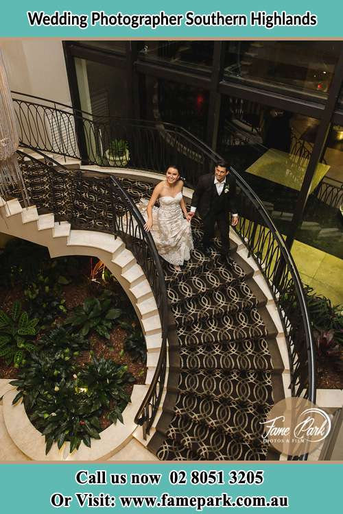 Bride and Groom going down the stairs Southern Highlands